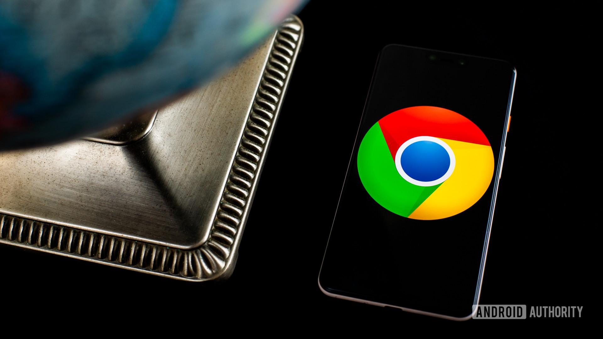 Logotipo do Chrome no smartphone ao lado do globo